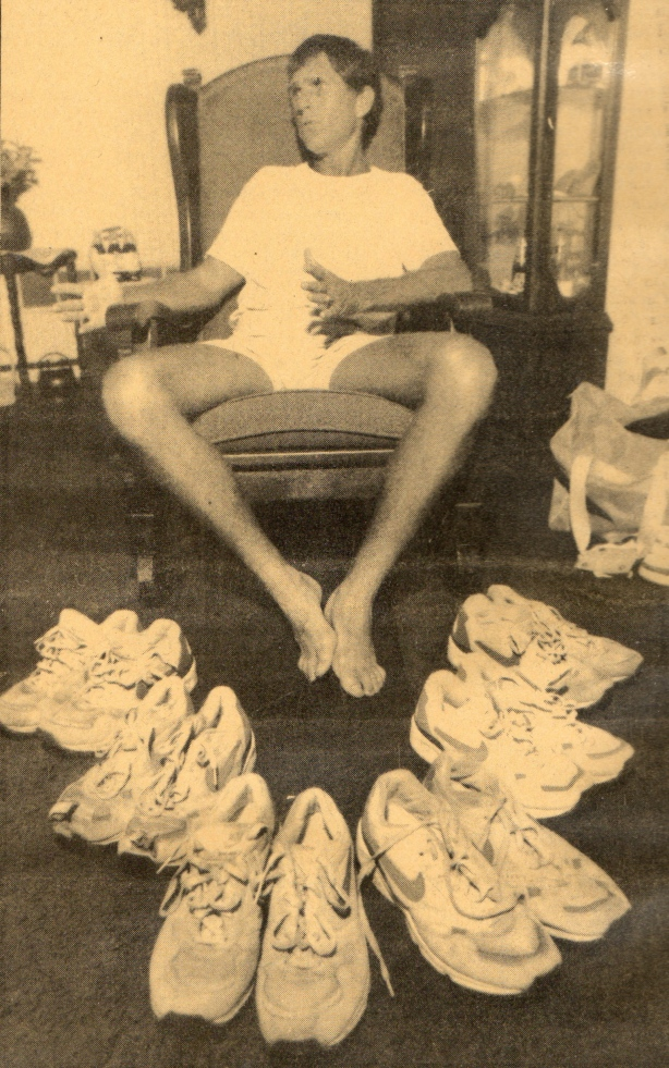 Lovejoy coach Richard Westbrook shows off the six pair of shoes that he wore in his cross-country run this summer. Note the shoes second from the left: Westbrook had to cut the toes out because his feet had swollen in the desert.