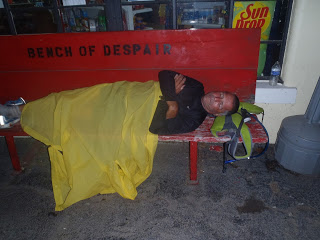 "Me sleeping on the ""Bench of Despair"" covered by my rain poncho. (Picture taken by Charlie Taylor)"